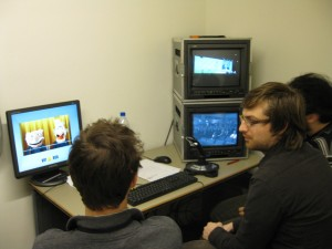 Techies watching monitors & cartoon set-up